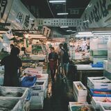 Person Waling on Market in Meat and Fish Section Royalty Free Stock Image