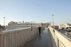 Person walking across a bridge, Lebanon. A person walking across a bridge in Lebanon Stock Images