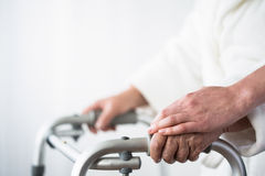 Person with walking aid. Photo of disabled old person with walking aid Royalty Free Stock Photo