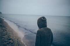 Person Walking Alone on Beach Royalty Free Stock Images