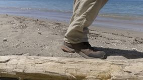 Person walking on beach. A medium shot of a person walking on beach stock video footage