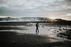 Person walking on the beach in Stokksnes, Iceland Stock Photos