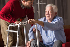 Person with walking disability. Photo of carer and person with walking disability Stock Images