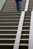 Person walking down stairs. Lady Royalty Free Stock Images
