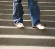 Person walking down steps Stock Photography