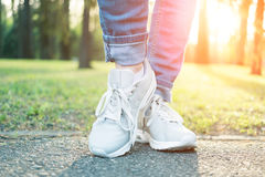 Person walking in gray running shoes, closeup Royalty Free Stock Photo