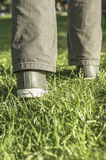 Person walking on green grass Stock Photo
