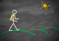 Person walking over hills. Drawing of a stick figure out of chalk at a blackboard showing a person hiking with a backpack having a walk over green hills with the Stock Images