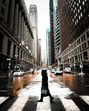 Person Walking On Pedestrian Lane Between Buildings stock images