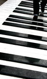Person walking on piano stock image