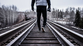 Person Walking on Railway during Day Time Royalty Free Stock Images