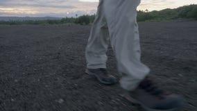 Person walking on rocks. A medium shot of a person walking on rocks stock video