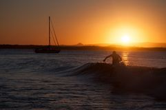 Person Walking In Sea Wave During Sunset Royalty Free Stock Photo