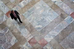 Person walking on tiled floor Stock Image