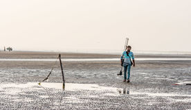 Free Person Walking With Camera And Tripod On Beach Stock Images - 99056124