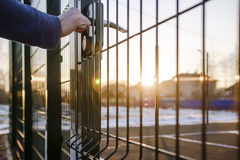 Person wants get in on playground through the little gate of wel Royalty Free Stock Images