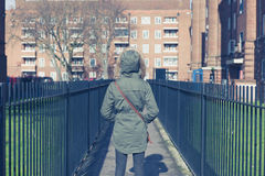 Person in warm coat walking on estate Royalty Free Stock Image