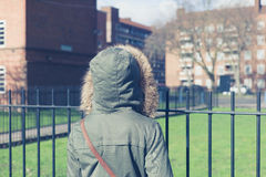 Person in warm coat walking on estate Royalty Free Stock Photo
