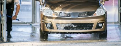 Free Person Washing His Car On A Station Woth A Special Cleaner, Car Wash Services Stock Image - 150396391