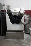 Person in washing machine Royalty Free Stock Image
