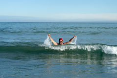 Person in the waves of the sea while having fun Royalty Free Stock Photography