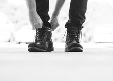 Person Wearing Black Leather Boots Royalty Free Stock Image