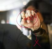 Person Wearing Black Watch Writing on Mirror Using Red Pen Royalty Free Stock Image