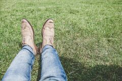 Person Wearing Blue Denim Jeans Sitting on Grass Royalty Free Stock Image