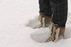 Person wearing boots standing in deep snow. Person wearing leather boots standing in deep snow Stock Photo