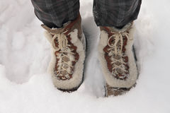 Person wearing boots standing in deep snow. Person wearing leather boots standing in deep snow Royalty Free Stock Images