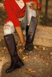 Person Wearing Brown Leather Wide-calf Boots royalty free stock photos