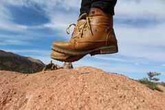 Person Wearing Brown Leather Work Boots during Daytime Royalty Free Stock Image