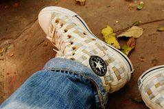 Person Wearing Brown and White Converse All Star Woven High Top Sneakers Stock Images