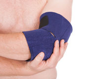 A Person Wearing Elbow Brace Stock Image