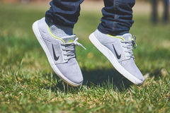 Person Wearing Grey and White Nike Sneaker Stock Photography