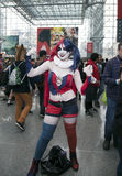 Person wearing Harley Quinn costume with others at NY Comic Con Royalty Free Stock Image