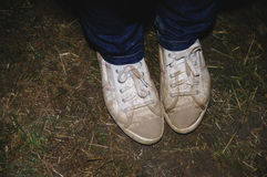 Person wearing jeans and sneakers Stock Photos
