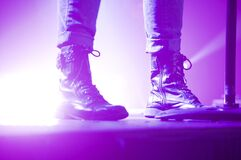 Person Wearing Lace Up Boots Standing on Stage Stock Photos