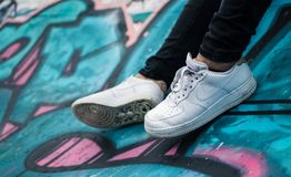 Person Wearing Pair of White Nike Air Sneakers stock photo