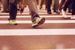 Anonymous man wearing running shoes is going through the crosswa royalty free stock photos