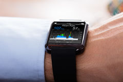 Person Wearing Smart Watch Showing Heartbeat Rate royalty free stock image