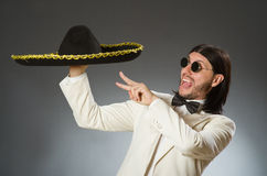 The person wearing sombrero hat in funny concept. Person wearing sombrero hat in funny concept Stock Photo