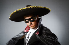The person wearing sombrero hat in funny concept. Person wearing sombrero hat in funny concept Royalty Free Stock Image
