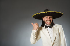 Person wearing sombrero hat in funny concept Stock Image