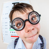 Person wearing spectacles in an office at the doctor Royalty Free Stock Image