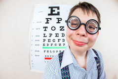 Person wearing spectacles in an office at the doctor Royalty Free Stock Images