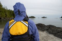 Person wearing waterproofs and a life jacket royalty free stock photo