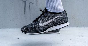 Person Wearing White and Black Nike Sneakers Royalty Free Stock Photography