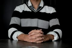 Person Wearing White and Black Striped Sweater Sitting stock photo