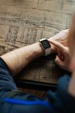 Person Wearing White Strap Stainless Steel Case Smartwatch Royalty Free Stock Photo